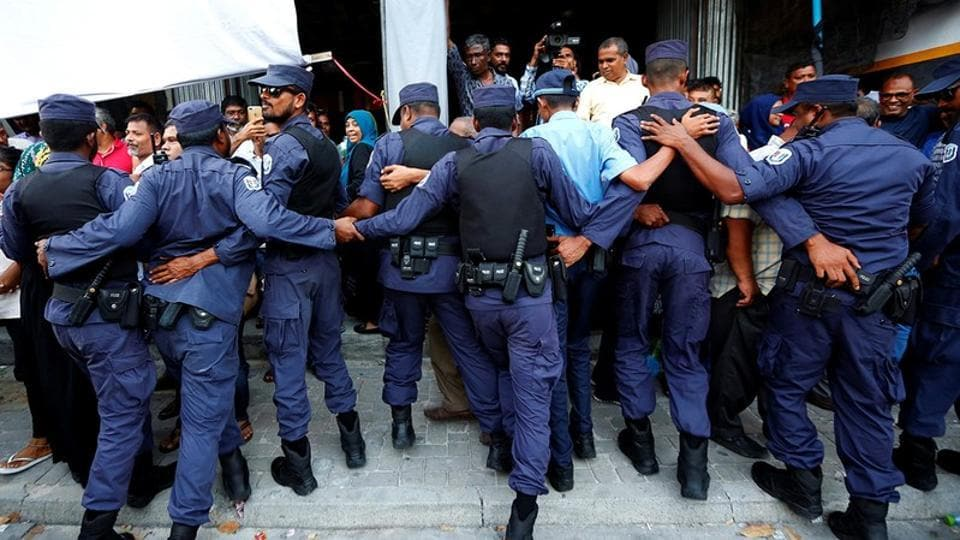 Maldivian Police officers push back opposition supporters near the main opposition Maldives Democratic Party (MDP) headquarters during a protest  in Male, Maldives.