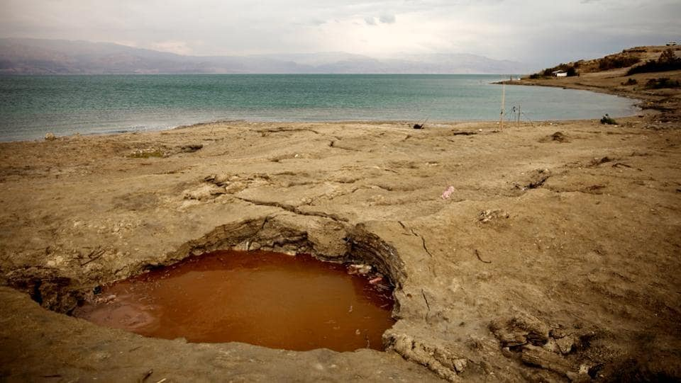 But in recent years, beaches have shut down as signs warning against sinkholes have sprung up along the shoreline. The sinkholes are a result of mineral mining and the interaction between freshwater and a salt layer, buried deep beneath the surface. As fresh water dissolves the salt, it creates an underground void, leading to sudden collapses on the surface. (Ronen Zvulun / REUTERS)