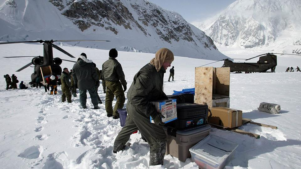 In this April 15, 2002, file photo, members of the U.S. Army's High Altitude Rescue Team from Fort Wainwright Army Base near Fairbanks, Alaska, unload supplies from the team's CH-47 Chinook helicopters for the National Park Service's 7,000-foot level Mount McKinley base camp on the Kahiltna Glacier near Talkeetna, Alaska. The National Park Service is considering new rules for the disposal of human waste generated by climbers on North America's tallest mountain, Denali.
