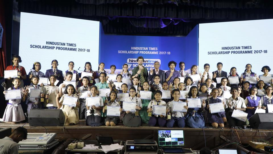 Winners of the HT Scholarship Programme pose with chief guests during the event held at Jawaharlal Nehru Memorial Hall, Camp, on Tuesday.