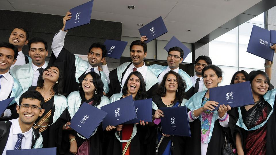 IIM Indore Students flaunt their degress after the convocation ceremony in Indore, India, on Saturday, March 28, 2015.