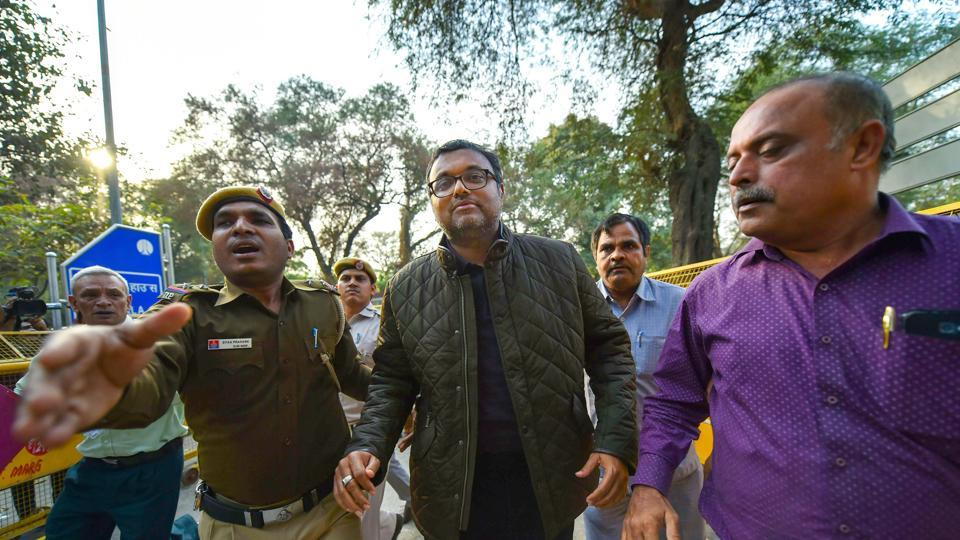Karti Chidambaram, son of former union minister P Chidambaram, being escorted by police personnel to a court in New Delhi on Wednesday.