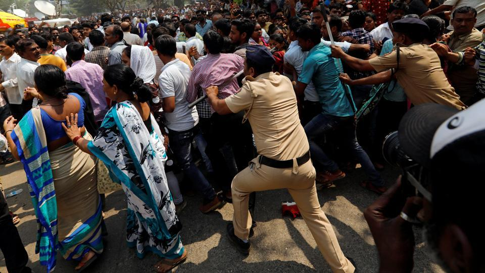 Fans of Bollywood actor Sridevi are pushed by policemen as they wait to offer condolences outside a makeshift memorial in Mumbai. As hours passed, the police tried to control the ever-increasing crowd gathered since morning outside Celebration Sports Club, resorting also to lathi-charge. (Danish Siddiqui / REUTERS)