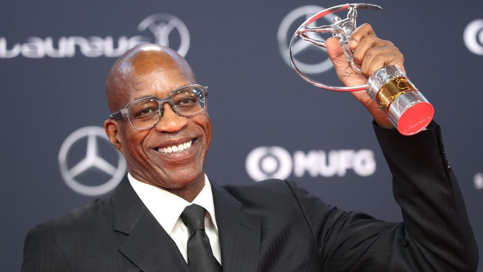 Edwin Moses poses with his Laureus lifetime achievement award trophy during the 2018 Laureus World Sports Awards. (AFP)