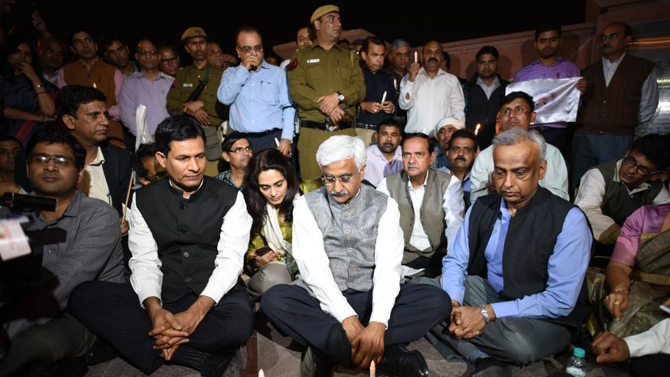 Chief secretary Anshu Prakash and other officers and employees of the Delhi government outside Rajghat  on Wednesday.