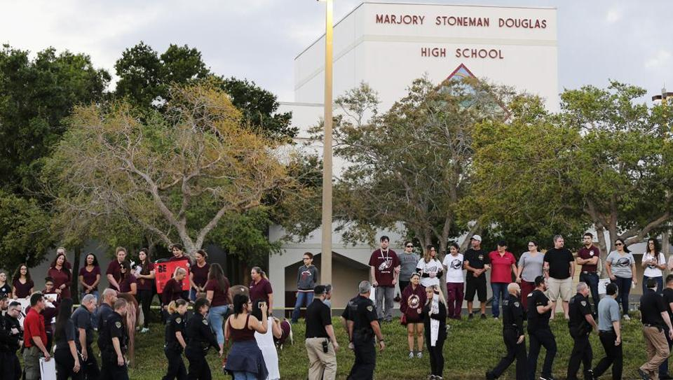 Police walk outside Marjory Stoneman Douglas High School in Parkland, Florida on February 28.