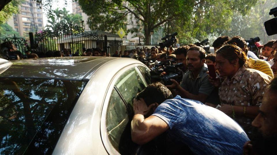 A fan is trying to see Anil Kapoor and Sanjay Kapoor through the car window outside Sridevi's Lokhandwala residence.