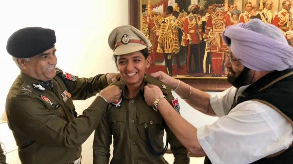 Punjab chief minister Captain Amarinder Singh and director general of police Suresh Arora pinning the stars on her uniform.