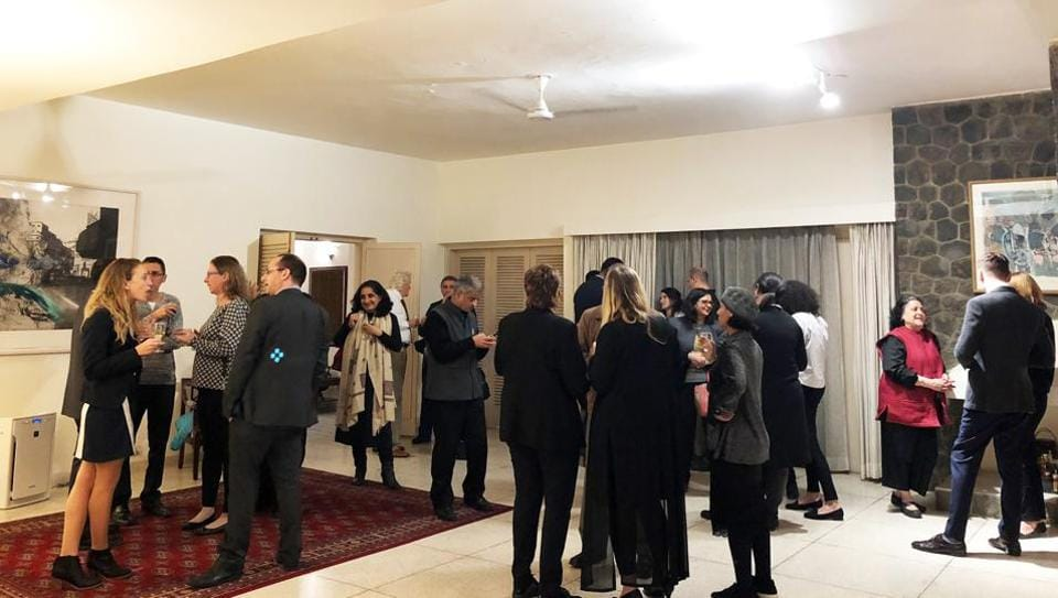 Guests at a party at a foreign diplomat's residence.