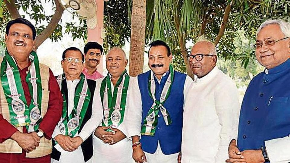 Bihar chief minister Nitish Kumar with former state Congress chief Ashok Choudhary (third from right) and three other MLCs after they joined the Janata Dal (United) in Patna on Thursday.