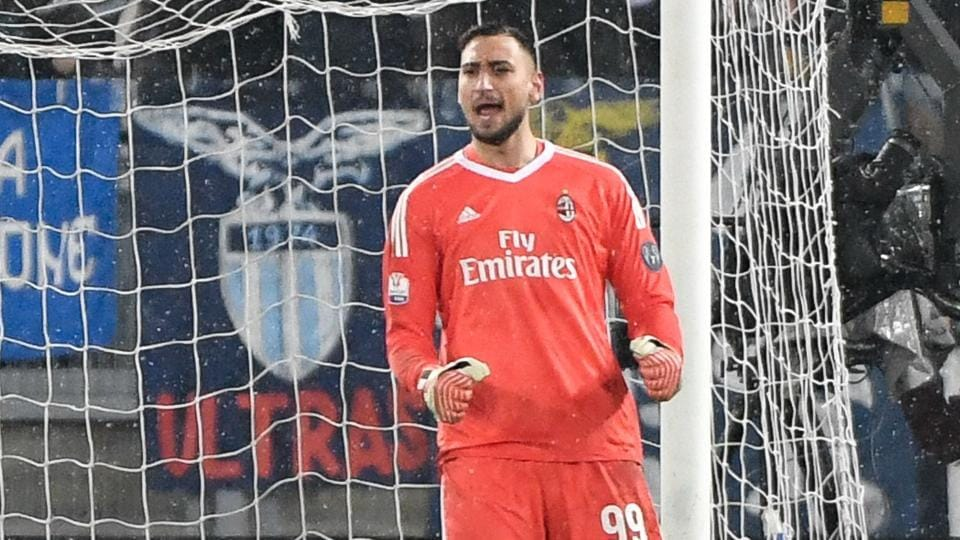 AC Milan's goalkeeper from Italy Gianluigi Donnarumma celebrates saving during a penalty shoot out in the Italian Cup semi-final football match against Lazio and Milan at The