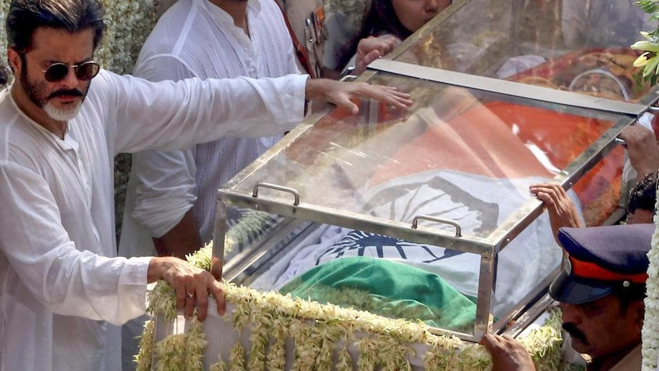 Anil Kapoor near Sridevi's mortal remains, wrapped in the national flag and placed in a glass casket, during her funeral procession in Mumbai on Wednesday.