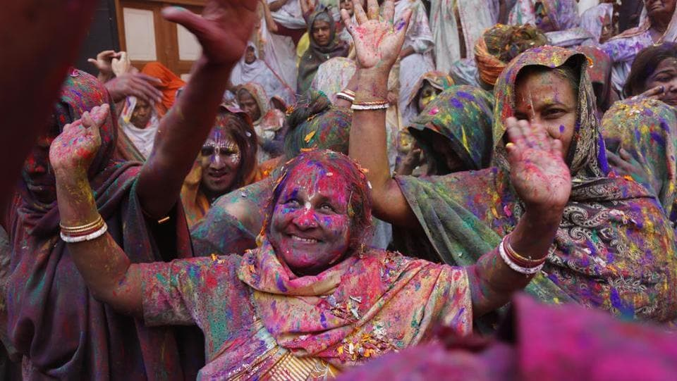 Women sing and dance as they celebrate Holi in the Gopinath temple at Vrindavan. The festival of colour will be celebrated across the country on March 2 this year.  (Sanchit Khanna /  HT Photo)