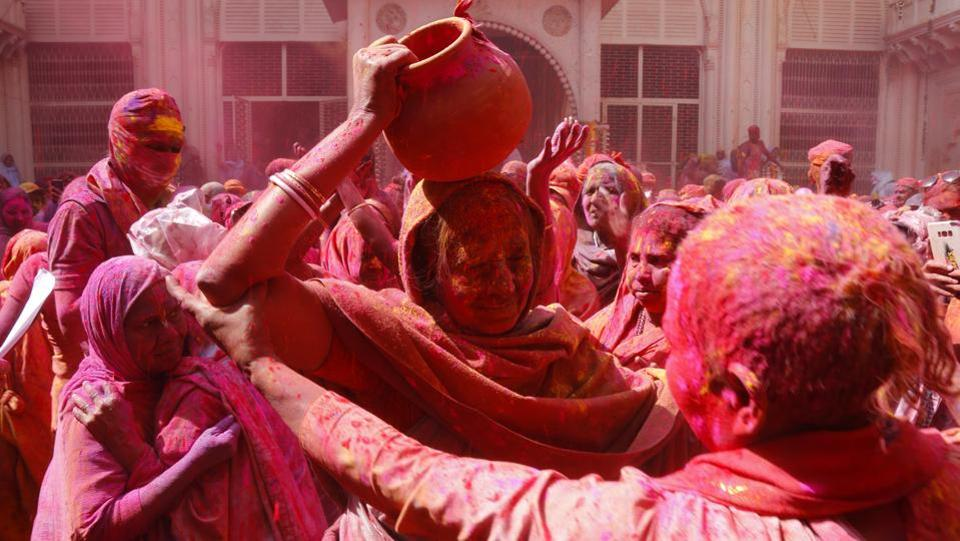 Apart from celebrating Holi with fellow 'widow sisters', the residents of the ashrams have prepared 11 big earthen pots of herbal gulaal in various hues  intended for the Prime Minister. Sulabh founder Bindeshwar Pathak, who organised the Holi for widows in Vrindavan, said they have struck a special bond with the Prime Minister and consider him a brother. (Sanchit Khanna / HT Photo)