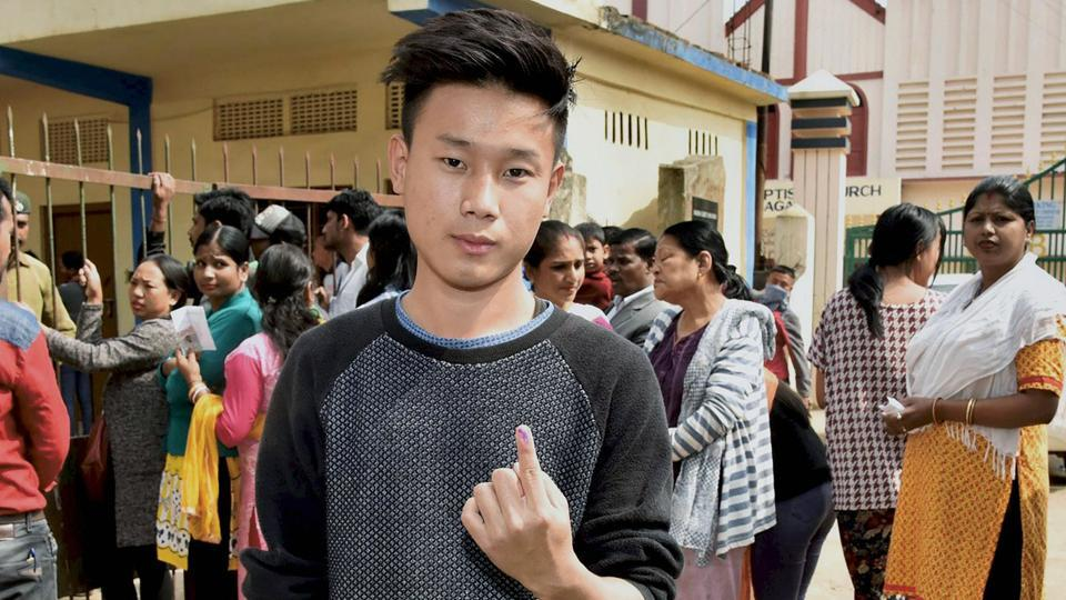 A young voter shows his finger marked with indelible ink after he cast his vote during the Nagaland assembly elections, Dimapur, February 27