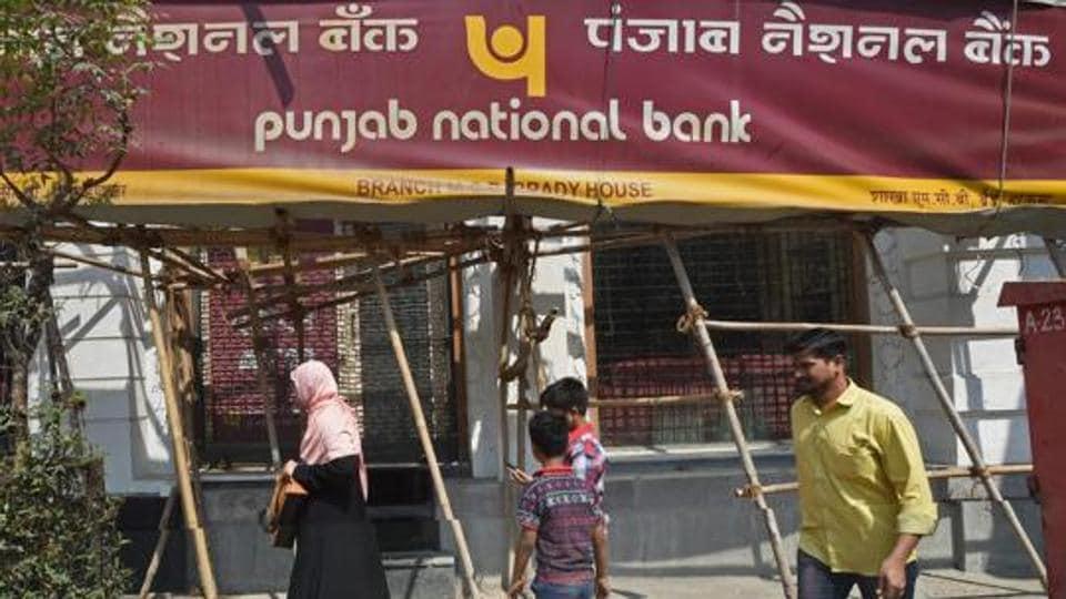 People walk past as a CBI team seals Punjab National Bank's South Mumbai branch at Brady House recently.