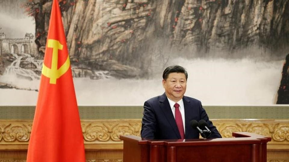 Chinese President Xi Jinping speaks as China's new Politburo Standing Committee members meet with the press at the Great Hall of the People in Beijing, China.
