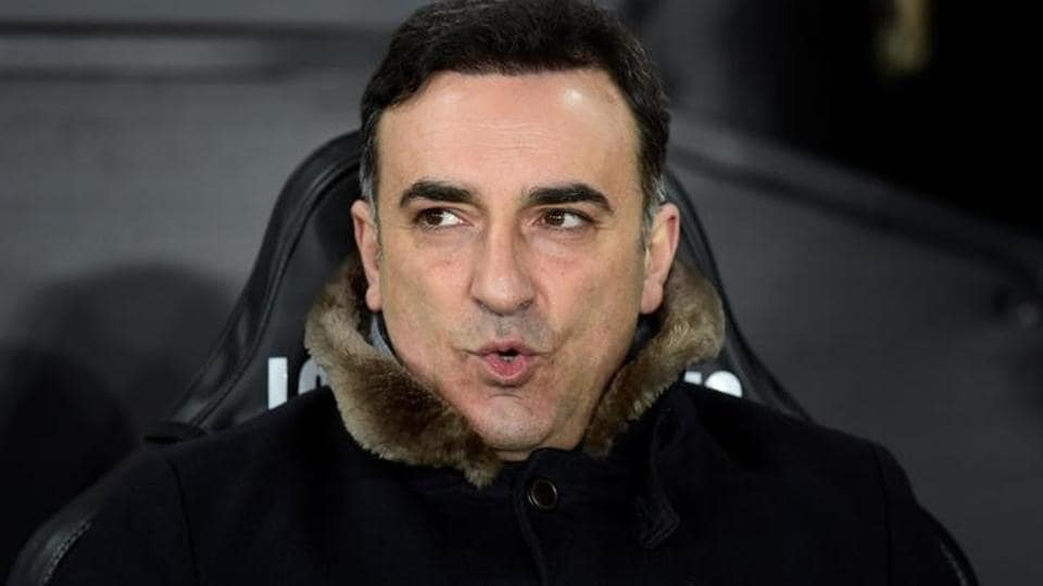 Swansea City manager Carlos Carvalhal is not feeling the pressure of his club's relegation battle in the Premier League.