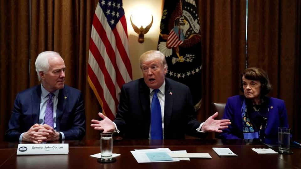 Flanked by Senators John Cornyn (R-TX) and Dianne Feinstein (D-CA) US President Donald Trump meets with bi-partisan members of Congress to discuss school and community safety in the wake of the Florida school shootings at the White House in Washington