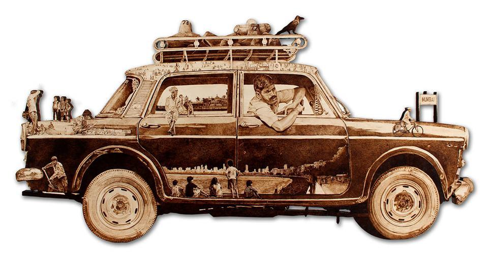 Mumbai Darshan by Ahmedabad-based Mehul Rathod employs pyrography on wood to recreate a city taxi.