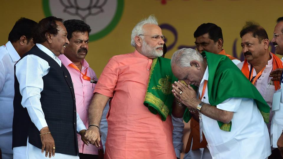 Prime Minister Narendra Modi with Karnataka BJP President, chief ministerial candidate B S Yeddyurappa and party leader K S Eshwarappaduring the party's 'Farmers Convention' at Davanagere, Karnataka. (Shailendra Bhojak / PTI)