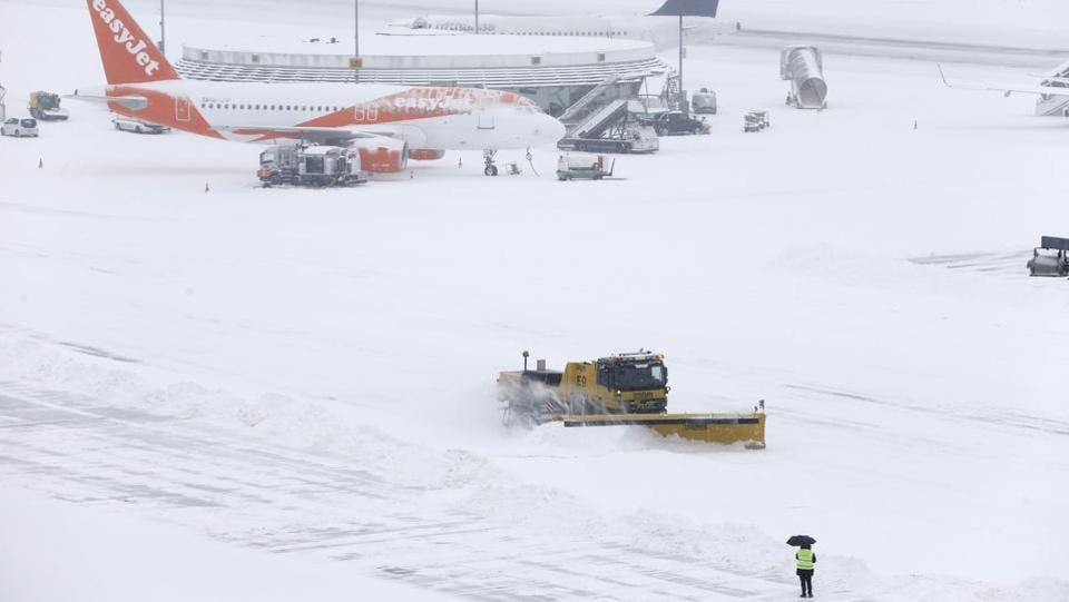 A plough removes snow next to EasyJet and Lufhansa aircraft during a temporary closure at Cointrin airport in Geneva, Switzerland. Nearly all train operators warned of cancellations and disruption and hundreds of flights were cancelled. (Pierre Albouy / REUTERS)