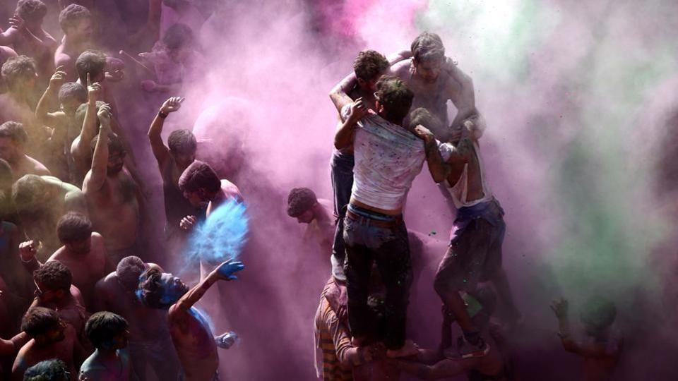 Devotees and tourists celebrate Holi in Pushkar, Rajasthan. Colour-smeared people greeted each other and spread happiness, as the whole country celebrated Holi with great fervour on Friday. (Himanshu Sharma / AFP)