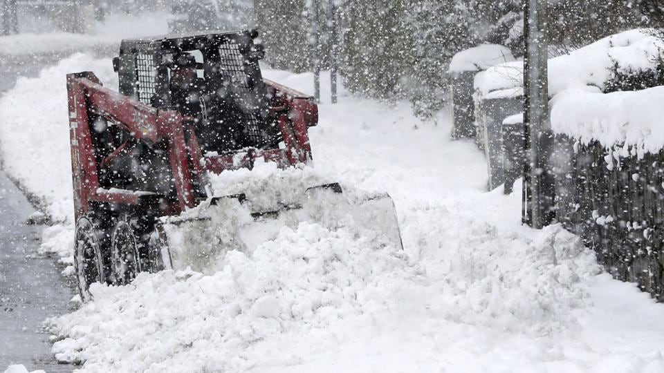 Persistent snow and freezing conditions caused delays in many parts of Britain, with roads and train service hit particularly hard. Emergency officials said many drivers had to be rescued from stranded vehicles. (Niall Carson / AP)