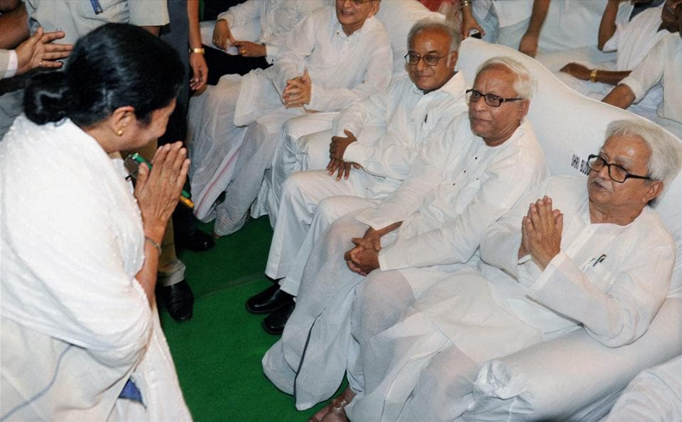After years of acrimony Trinamool supremo Mamata Banerjee exchanged greetings with former chief minister Buddhadeb Bhattacharjee (seated in the middle) before she was sworn in as chief minister on May 20, 2011.