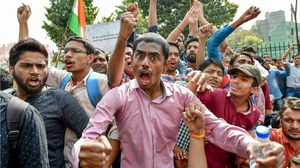 Staff Selection Commission (SSC) aspirants stage a protest demanding a CBI probe into an alleged paper leak outside SSC building, at Lodhi Road in New Delhi. (Arun Sharma / PTI)