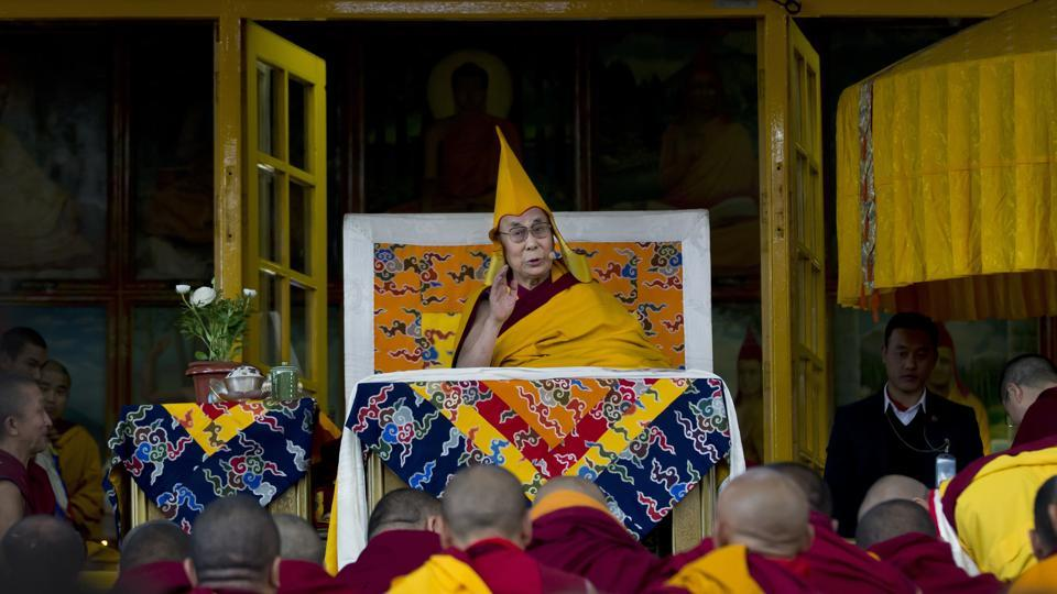Tibetan spiritual leader the Dalai Lama wears the ceremonial hat of the Gelug school of the Tibetan Buddhism as he gives a religious talk at the Tsuglakhang temple in Dharmsala, India on  Friday. (Ashwini Bhatia) / AP)