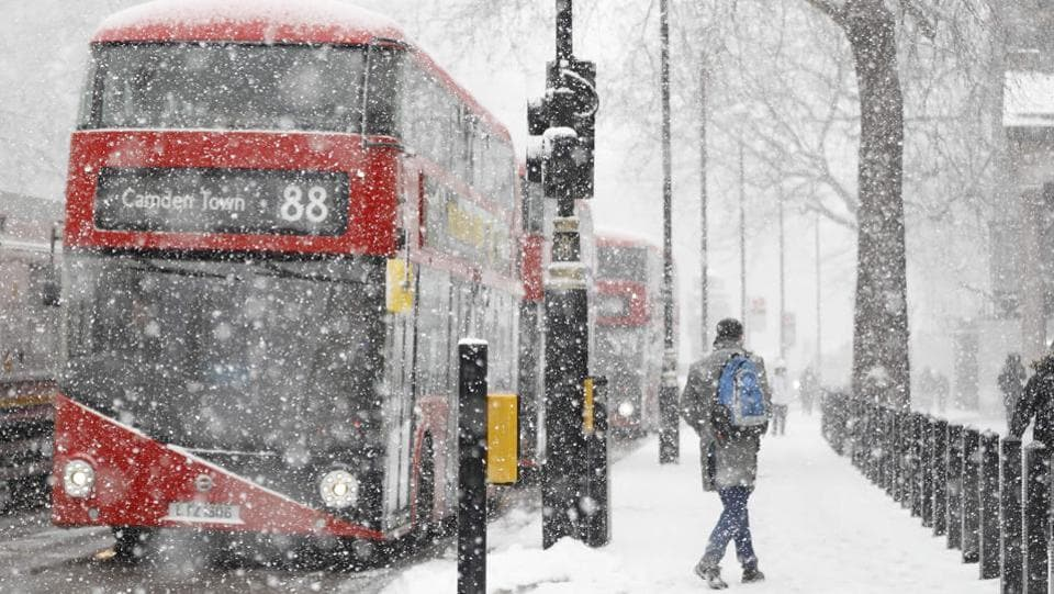 "A man walks during a blizzard in central London as temperatures remain below freezing point. The weather in Britain and northwestern Europe is to some extent a mirror image of the ""sudden stratospheric warming"" in the arctic, experts say, referring to a disturbance in the polar jet stream that has alarmed scientists. (Tolga Akmen / AFP)"