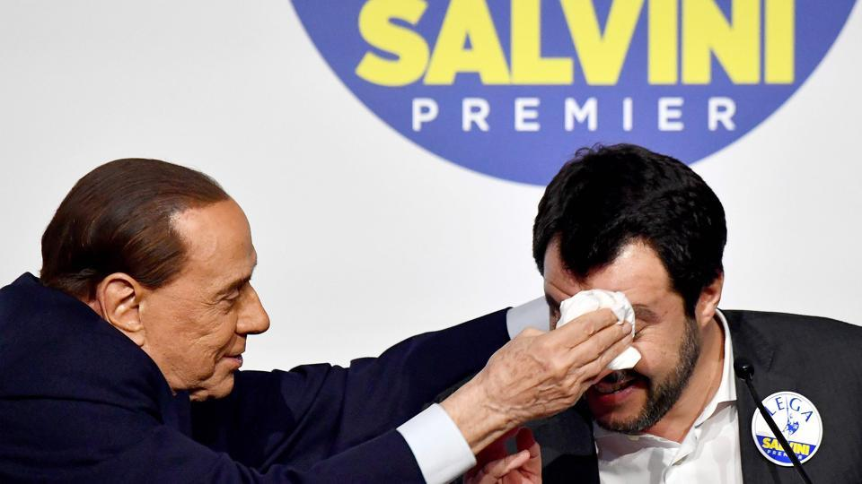Silvio Berlusconi (L) wipes the forehead of the League's Matteo Salvini, as he jokes with him during a press conference with Brothers of Italy (unseen) at the in Rome. Berlusconi's rightwing coalition, on course to win the most votes in Italy's election, held its first and last public meeting on March 1 in an attempt to quell speculation of severe internal divisions. (Alberto Pizzoli / AFP)