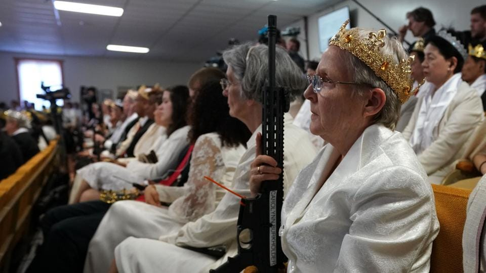Hundreds of worshipers gathered inside World Peace and Unification Sanctuary in Pennsylvania at a blessing ceremony for couples featuring their AR-15 rifles which they claim symbolize the