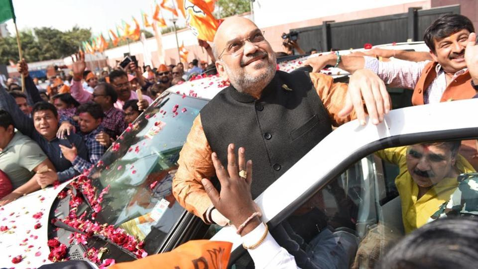 Amit Shah, national president of the Bharatiya Janata Party (BJP), celebrates with supporters outside the BJP headquarters in New Delhi on March 3, 2018.
