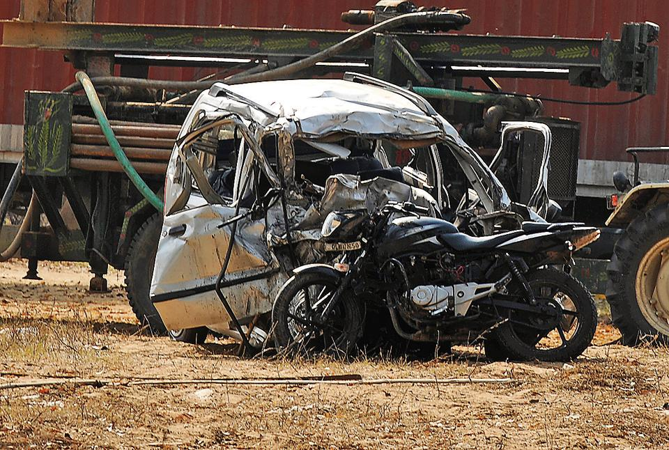 The mangled Wagon R and the Bajaj Pulsar motorbike which were hit by the canter truck on the Gurgaon-Pataudi Road on Saturday.