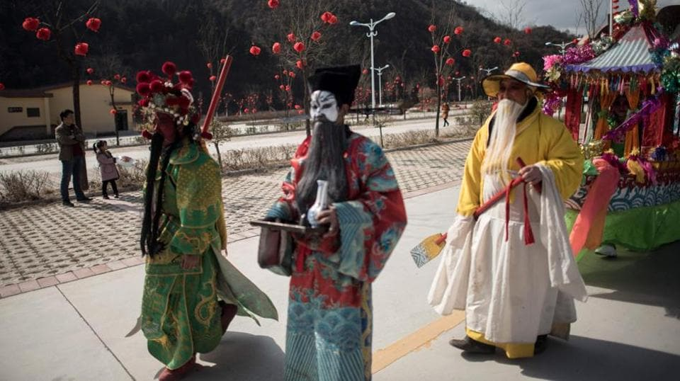 Villagers dressed in traditional costumes as they parade during the She Huo festival.