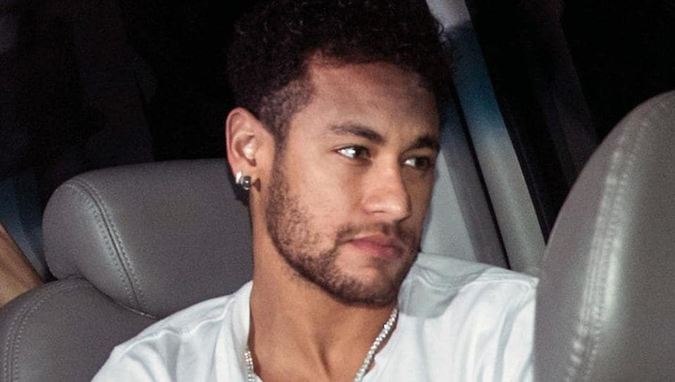 Brazilian superstar Neymar is pictured upon his arrival in Belo Horizonte on Friday ahead of an operation on his fractured foot.