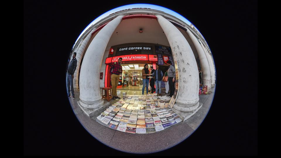 Over the decades, CP has presented itself not just as a shopping district for high end retail, but also as a destination for those love old and new books sold on pavements.  (Burhaan Kinu / HT Photo)