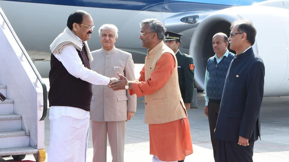 Chief minister TS Rawat greets Vice President Venkiah Naidu at the airport along with governor KK Paul.