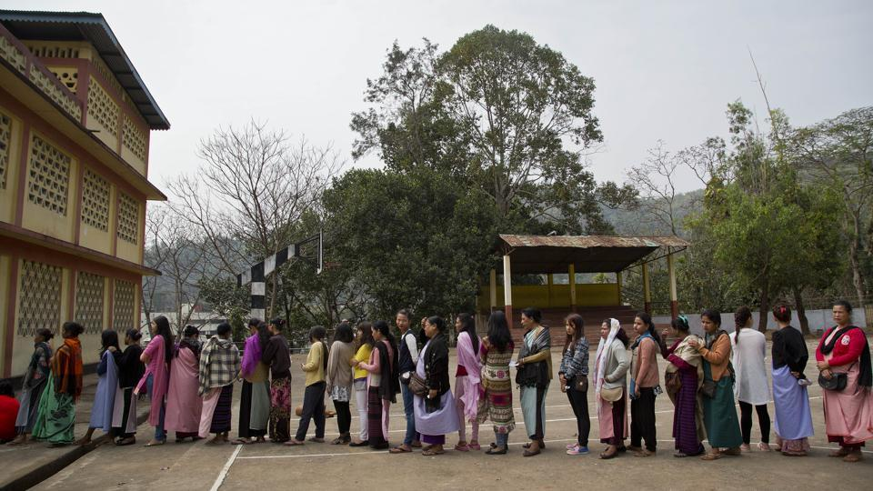 Khasi tribal people stand in a queue to cast their votes during the Meghalaya state assembly election in Nongpoh.
