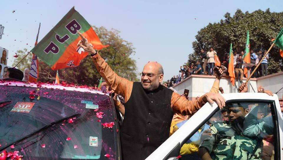 Amit Shah, president of the Bharatiya Janata Party (BJP), celebrates with supporters the state election results in three northeast states, outside the BJP headquarters in New Delhi
