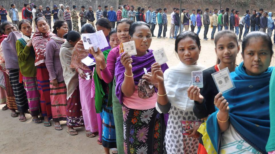 Women show their ID cards while waiting to cast their vote at a polling station during the state Assembly elections in Ri-Bohi district in Meghalaya on February 27, 2018.