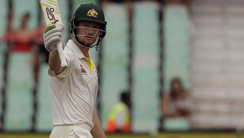 Australia batsman Cameron Bancroft raises his bat after reaching half-century on Day 3 of the first Test against South Africa at Kingsmead in Durban on Saturday.