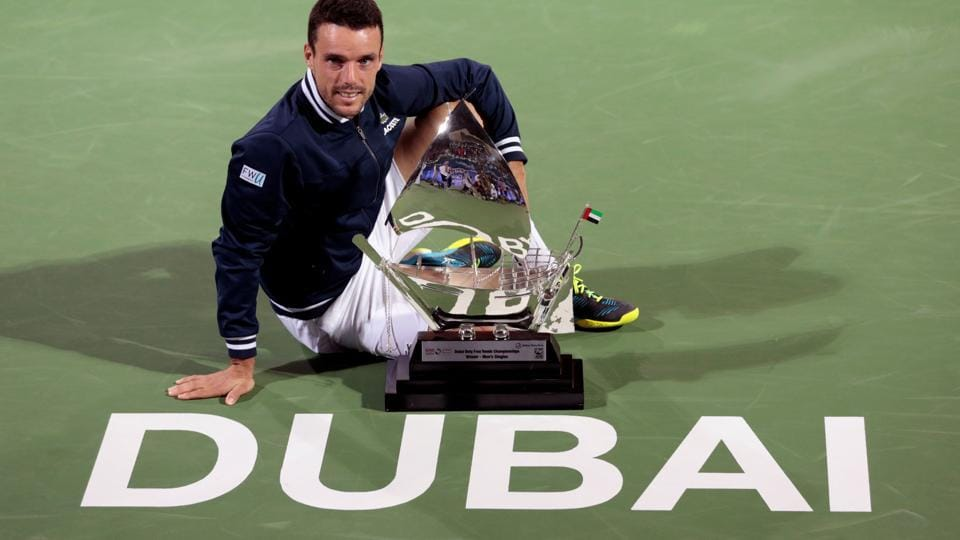 Roberto Bautista Agut of Spain poses with the trophy after defeating Lucas Pouille of France in the final of the Dubai Tennis Championships on Saturday.