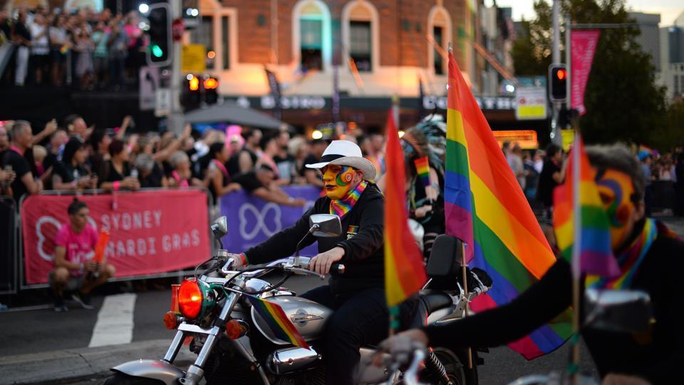 People participate in the annual Gay and Lesbian Mardi Gras parade in Sydney on March 3, 2018.