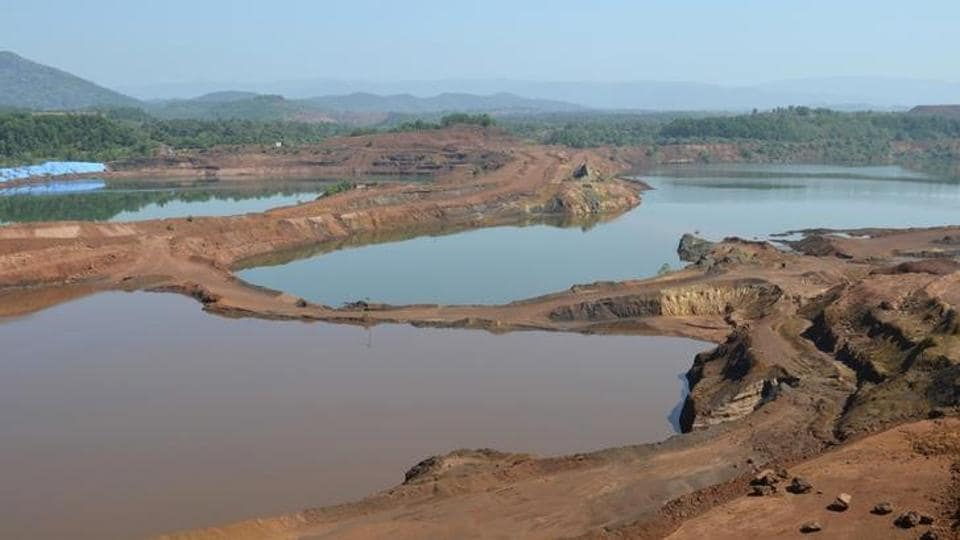 A general view shows the open pit of an iron ore mine in Codli village, in Goa.