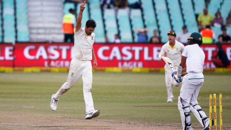 Australia bowler Mitchell Starc (L) celebrates taking the wicket of South Africa's Keshav Maharaj during the fourth day of the first Test cricket match between South Africa and Australia at The Kingsmead Stadium in Durban on March 4, 2018.