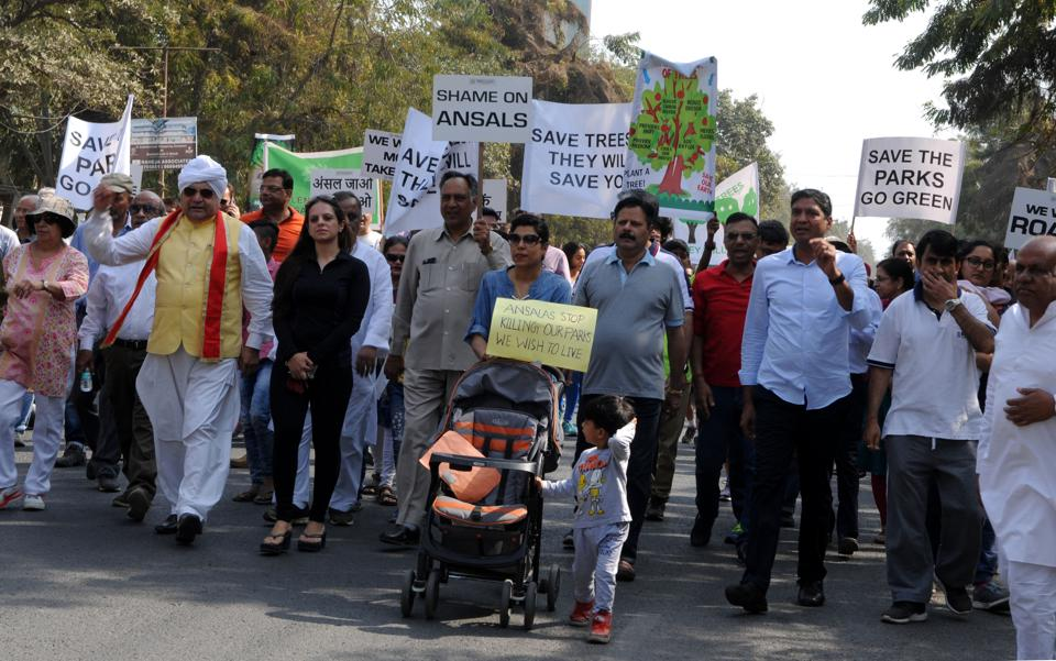 Gurgaon, India- March 04, 2018: Residents of Sushant Lok-1 protested for four hours on streets starting from Vyapar Kendra to Huda Metro station demanding takeover of the colony by the Municipal Corporation of Gurugram (MCG) which they alleged is long pending, in Gurgaon, India, on Sunday, March 04, 2018.