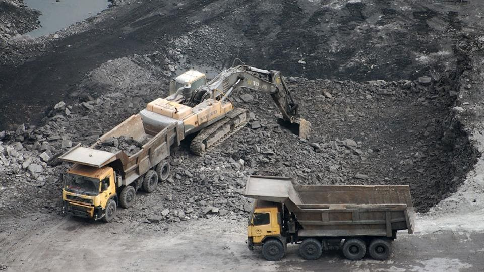 Coal is being loaded onto trucks at a coal mine in Dhanbad, Jharkhand.